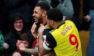 Andre Gray is congratulated by Troy Deeney after scoring Watford's second goal against Crystal Palace