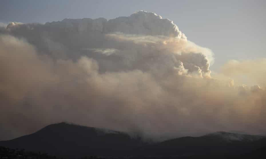 dark mountains seen with immense clouds and smoke above