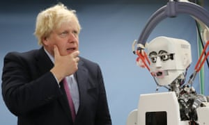 Boris Johnson with a robot at Waseda university in Tokyo.