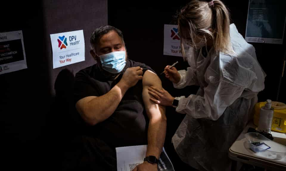 Meadow Heights resident Peter Resture, 52, recieves his second Pfizer shot at the Broadmeadows Town Hall