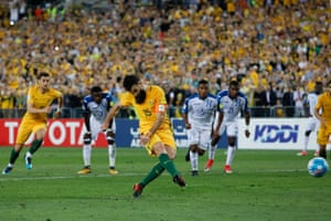 Jedinak places the ball beyond the keeper with his instep. 2-0.