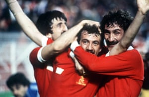 Alan Kennedy celebrates with David Johnson, (left) and Terry McDermott (right)