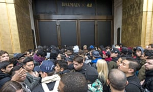 Customers wait outside H&M's Regent Street store ahead of the Balmain x H&M launch in London, November 2015