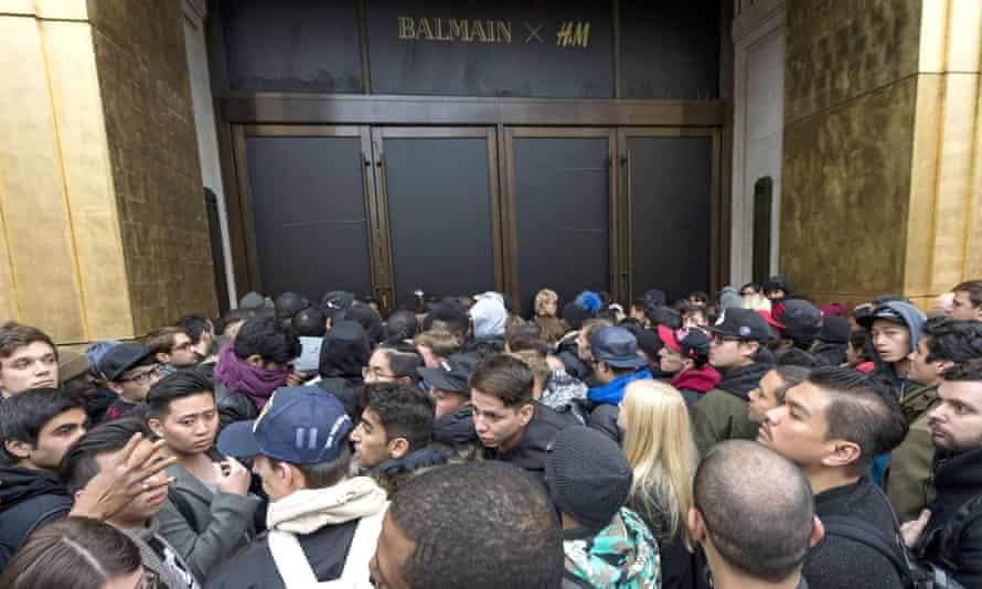 Customers wait outside H&M's Regent Street store ahead of the Balmain x H&M launch in London, November 2015