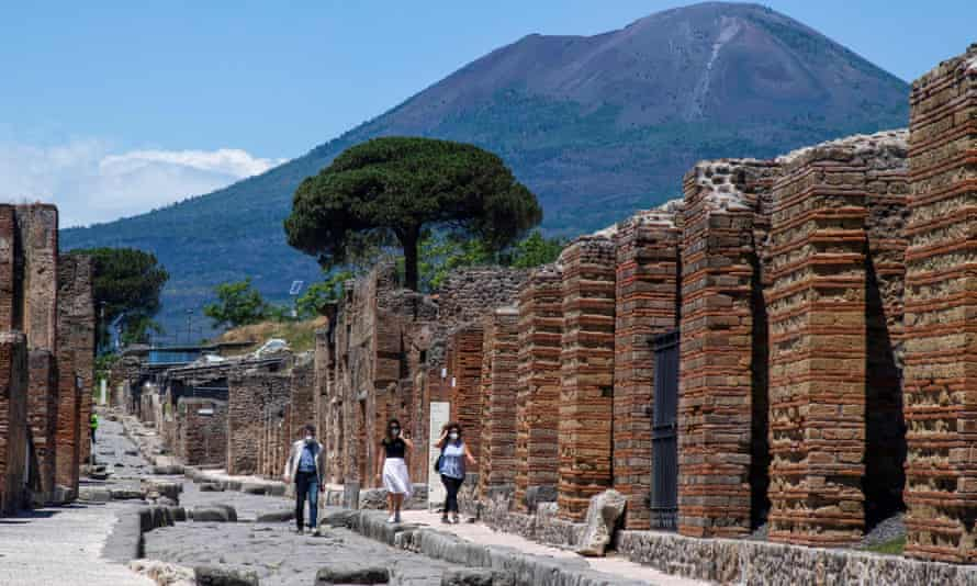 Visitors walk across the archeological site of Pompeii at the foot of Mount Vesuvius.