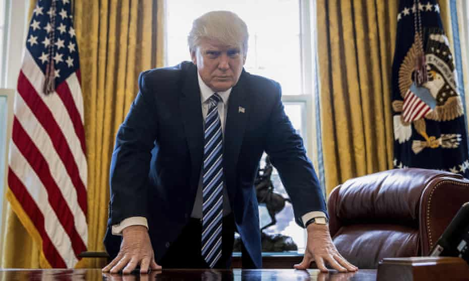 President Donald Trump in the Oval Office last Friday, in a portrait to mark his 100th day in office, which will be on 29 April.