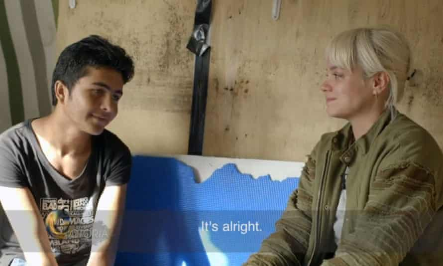 Lily Allen meets a 13-year-old boy from Afghanistan during her visit to the Calais refugee camp in October 2016.