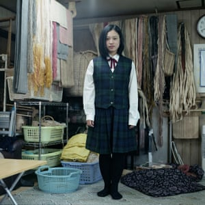 Maya, 15, in school uniform at her grandmother's Attush weaving workshop. Maya was born to an Ainu mother and a Japanese father