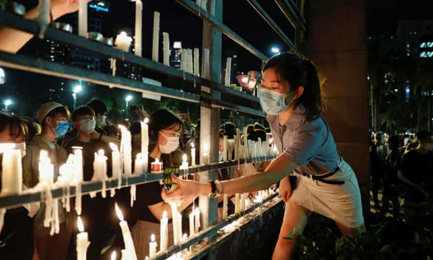 Protesters in Hong Kong take part in a vigil to mark the 31st anniversary of the crackdown of pro-democracy protests at Beijing's Tiananmen Square.