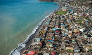 Aerial view of Roseau, capital of the Caribbean island of Dominica, shows destruction on 21 September, 2017, three days after the passage of Hurricane Maria.