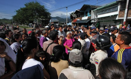 Venezuelans storm Colombia border city in search of food and basic goods