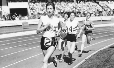 Diane Leather leading the field during a race at White City stadium, London, in 1957.