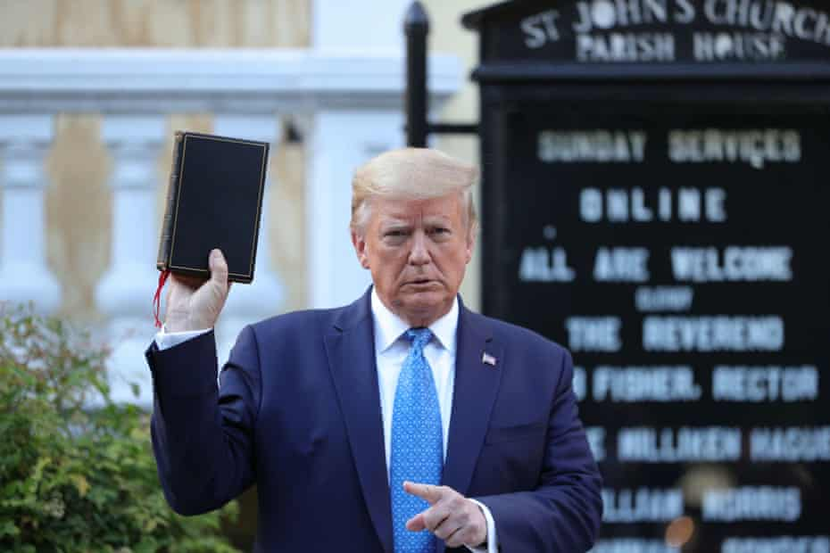 Donald Trump holds up a Bible during a photo opportunity in front of St John's Episcopal church on Monday.