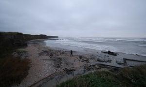 A man walks along the beach in Balbriggan, north of Dublin, near the scene where the body of a newborn baby was found.