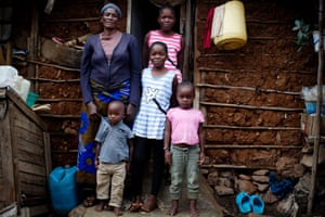 Rosemary with her grandchildren on the steps of their home in Kibera