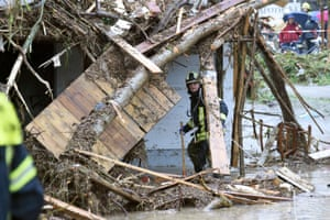 Simbach am Inn, Germany A firefighter inspects driftwood that was washed on to a house by the floods