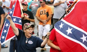 A woman waves her flag during a pro-Confederate flag rally at Stone Mountain Park on Saturday.