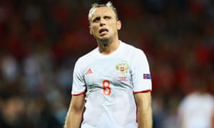 Denis Glushakov of Russia cuts a dejected figure after defeat by Wales.