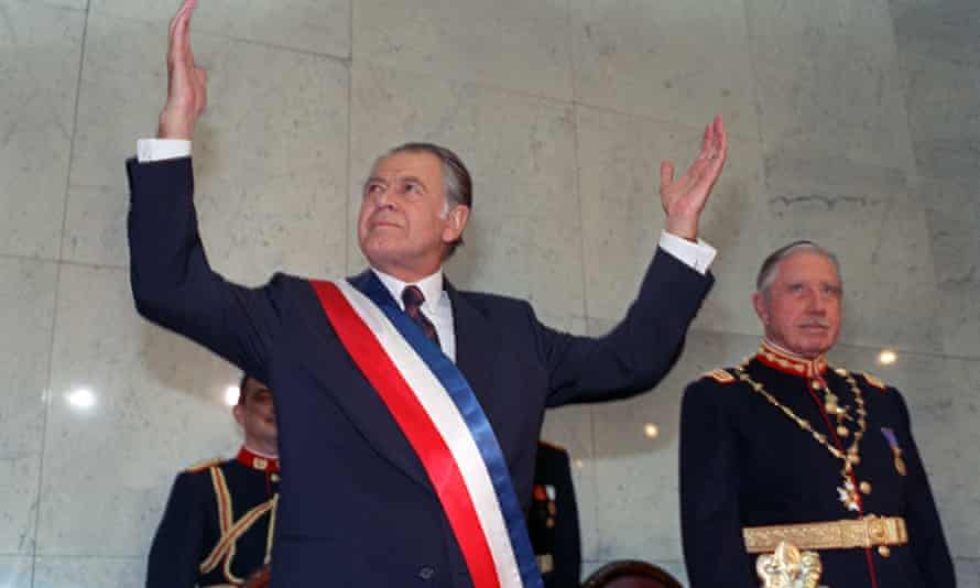 Patricio Aylwin receiving the presidential sash during an inauguration ceremony in 1990, as outgoing president, General Augusto Pinochet, right, looks on.