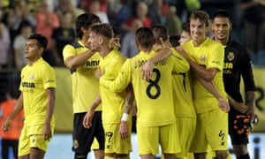 Villarreal's players celebrate their victory over Atletico Madrid which sent them top of La Liga.