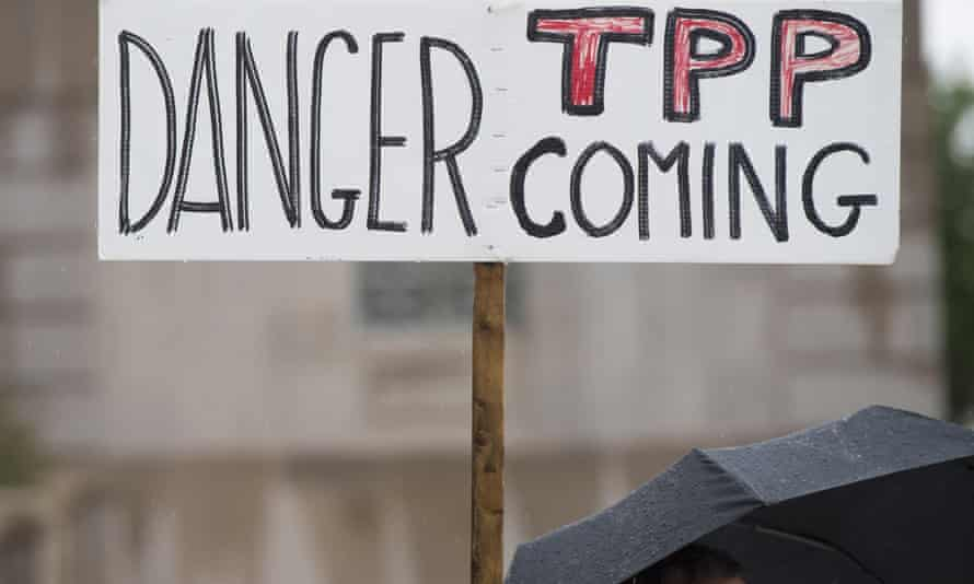 Demonstrators protest against the legislation to give US President Barack Obama fast-track authority to advance trade deals, including the Trans-Pacific Partnership (TPP), during a protest march on Capitol Hill in Washington on 21 May.
