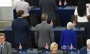 Brexity party leader and MEP Nigel Farage (centre, mid row) turns his back to defy the European parliament.