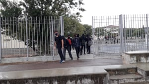 Pupils in Nicosia school exit premises wearing masks.