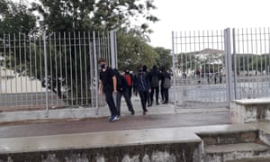 Mask-wearing schoolchildren leave school in Nicosia