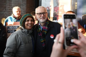 London, UK, Opposition Labour party leader Jeremy Corbyn poses for selfie while campaigning outside Finsbury Park station
