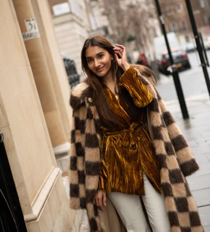 Eshita Kabra-Davies wearing a velvet jacket, a fur coat and cream trousers