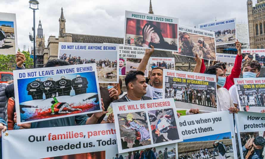 Supporters of Afghan refugees demonstrate outside parliament.