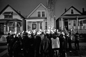 People gather on South Throop Street, to pay tribute to Albert Vaughn, 18, known as Li'l Albert, in April 2008.