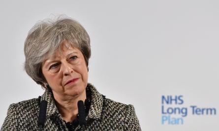 Theresa May behind NHS long term plan sign