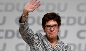 Annegret Kramp-Karrenbauer waves after being elected as the party leader during the Christian Democratic Union party congress.