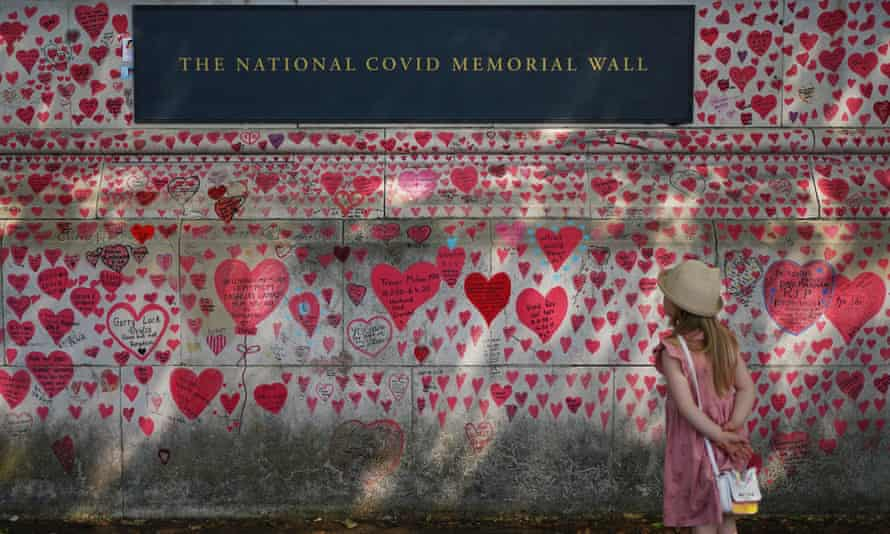 A child looking at the National Covid Memorial Wall