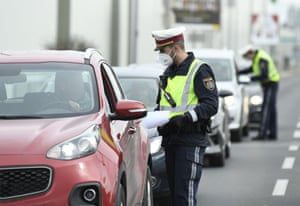 Policemen patrol checkpoints in Wiener Neustadt, Austria, after the city introduced exit checks in an attempt to curb the spread of coronavirus.