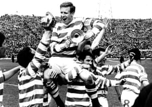 Celtic captain Billy McNeill clings on to the Scottish Cup as he is carried shoulder-high by his triumphant teammates after their 3-2 victory in 1965.