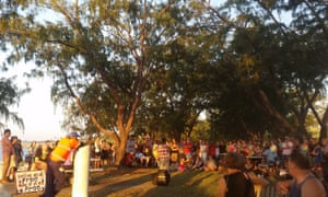 Some of the crowd at Nightcliff Jetty in Darwin listen to speeches.