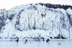 Children playing on a frozen lake outside Beijing. in the Yungyang xianjing suburb