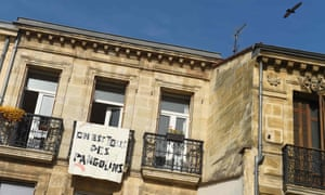 "A banner reading ""We are all pangolins"" hangs on a balcony in Bordeaux, France"