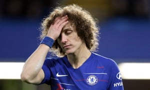 David Luiz appears dejected during the comprehensive defeat against Manchester United.