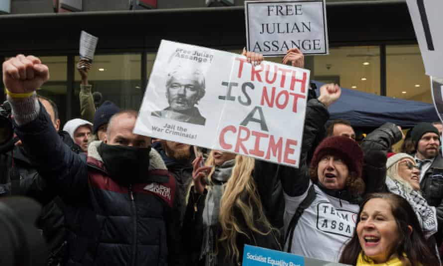 Supporters of Julian Assange cheer outside the Old Bailey in London