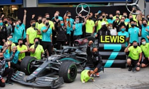 Lewis Hamilton celebrates after winning the Turkish Grand Prix to secure his seventh world championship.