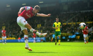 Aaron Ramsey volleys home the opening goal during Arsenal's 2-0 win at Norwich City in May 2014.