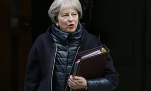 Theresa May leaves 10 Downing Street holding a folder