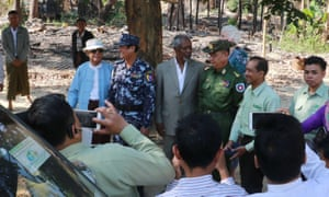 Kofi Annan, in grey suit, visits a burnt-out Rohingya village in Maungdaw, Rakhine state, on 3 December.