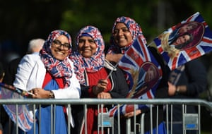 Well-wishers wearing union flags stand at the barriers on the Long Walk, which leads to Windsor Castle