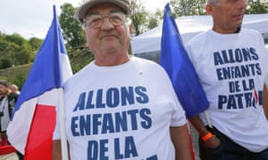Two Front National supporters wear T-shirts emblazoned with the first sentence of the French National anthem.