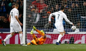 Real Madrid's Cristiano Ronaldo stabs the ball home after it was deflected into his path off a Wolfsburg defender.