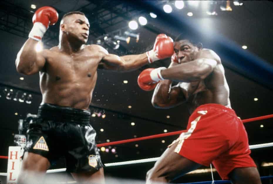 Mike Tyson (left) v Frank Bruno in 1989.